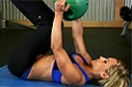 Exercise Guides: Knees In Side Rotation While Holding Medicine Ball, Female/Long Clip