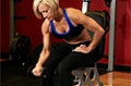 Exercise Guides: Seated One-Arm Dumbbell Palms-Down Wrist Curl, Female/Long Clip