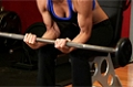Exercise Guides: Seated Palm-Up Barbell Wrist Curl, Female/Long Clip