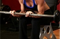 Exercise Guides: Seated Palms-Down Barbell Wrist Curl, Female/Long Clip